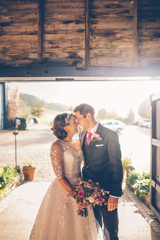 Bride in Tea Length Lace Justin Alexander Dress with birdcage veil ...