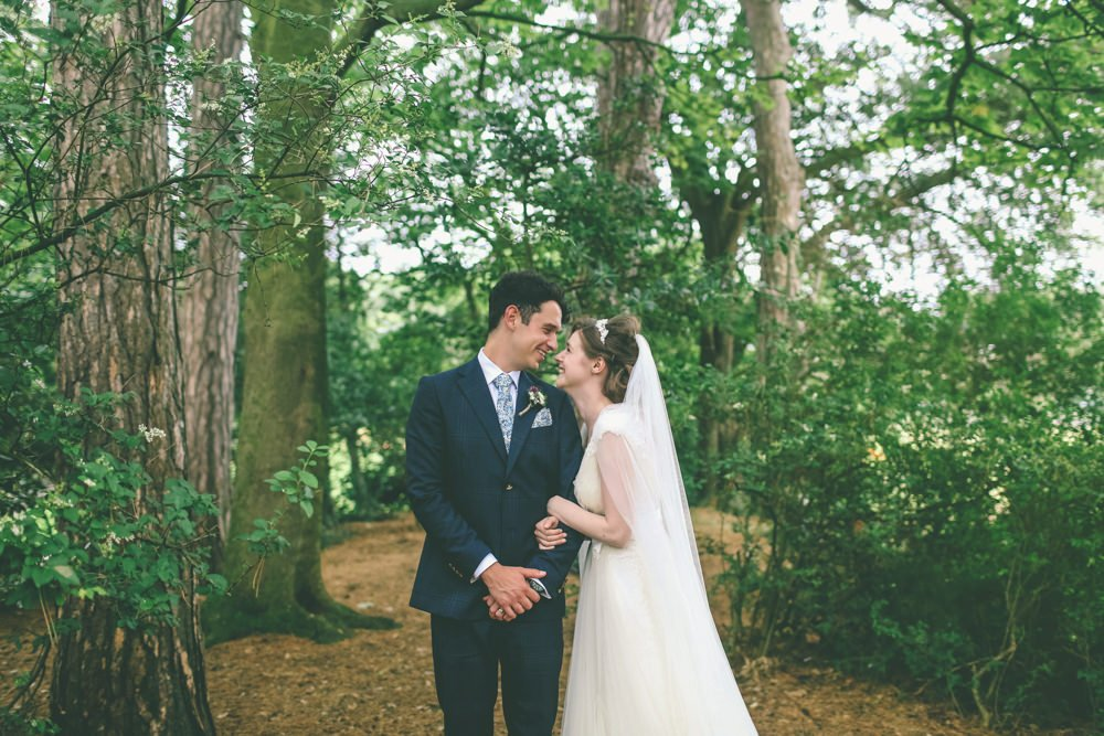 a vintage themed church hall wedding with the bride wearing annasul