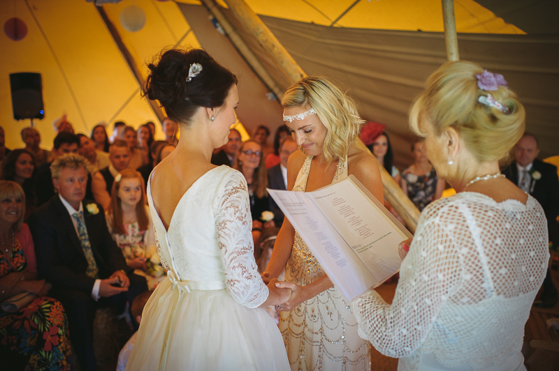 An English summer festival style wedding held in a Tipi Tent with a humanist ceremony with a bride in a Jenny Packham Luna dress and a bride in Miu Miu shoes and a Fur Coat No Knickers Bellini dress. my-for-rmw-guy-collier-photography-102-of-215