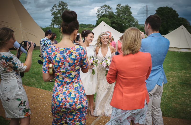 An English summer festival style wedding held in a Tipi Tent with a humanist ceremony with a bride in a Jenny Packham Luna dress and a bride in Miu Miu shoes and a Fur Coat No Knickers Bellini dress. -sammy-for-rmw-guy-collier-photography-121-of-215