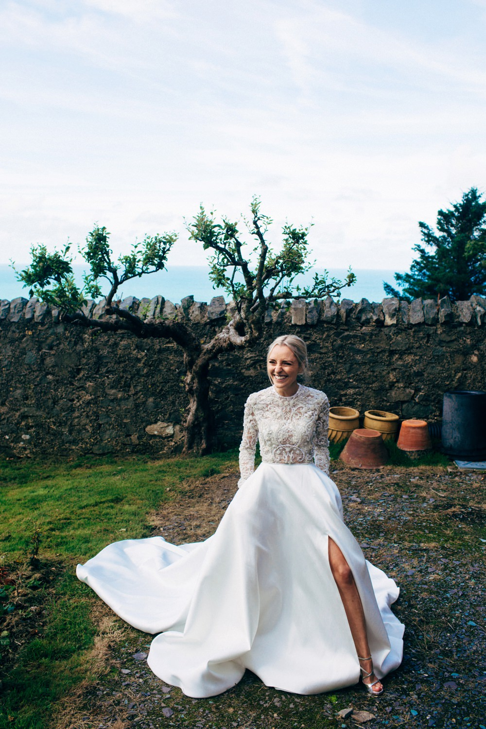 Stylish welsh wedding with emma beaumont gown grey bridesmaids bride in emma beaumont wedding dress ombrellifo Choice Image