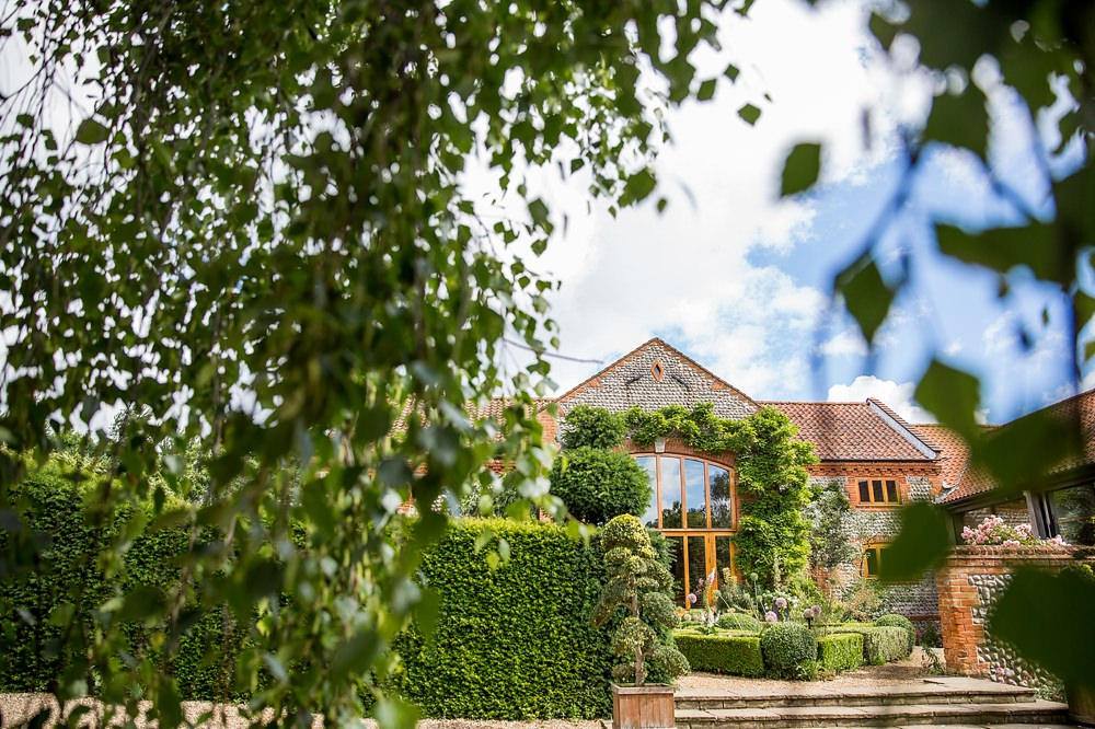 country wedding at chaucer barn in norfolk with raimon