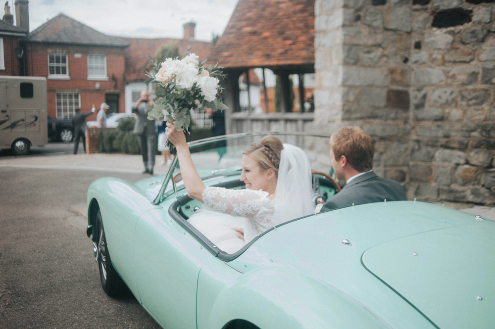 Pastel at home marquee wedding with pronovias neive bridal gown vintage wedding car exit with bride in pronovias white one wedding dress junglespirit Image collections