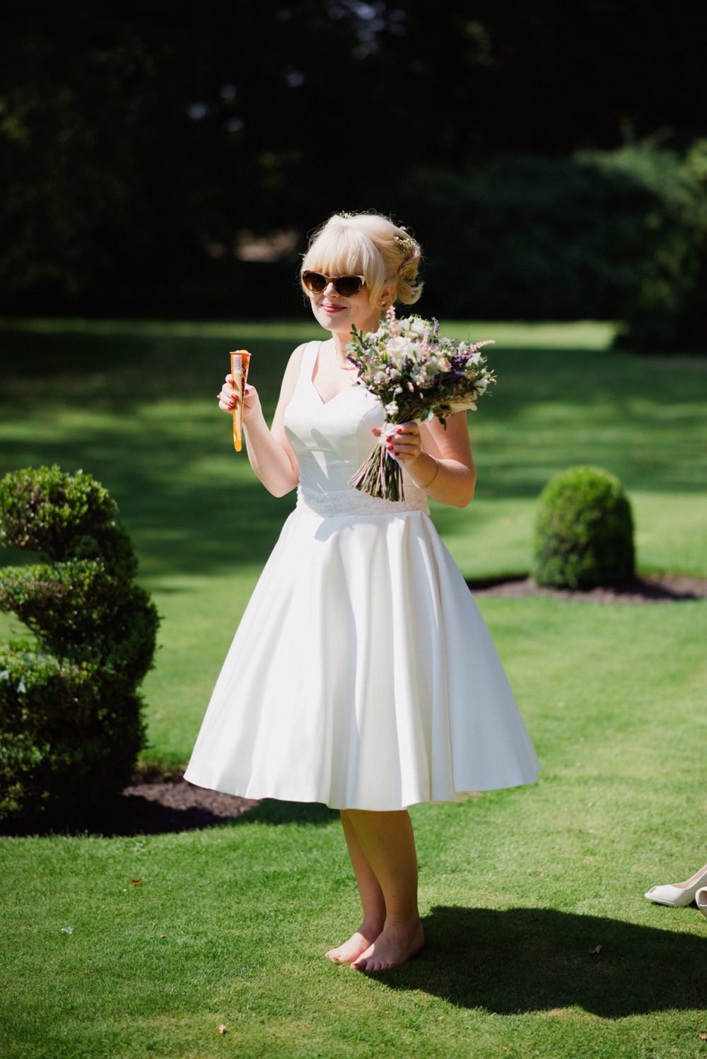 A vintage short wedding dress for an at home wedding in a yurt with image by a ombrellifo Images