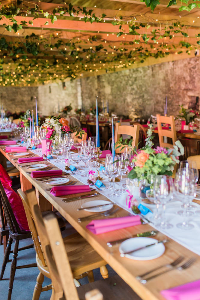 Outdoor wedding at windmill barn in scotland with indian summer theme wedding with bright pink blue colour scheme junglespirit Choice Image