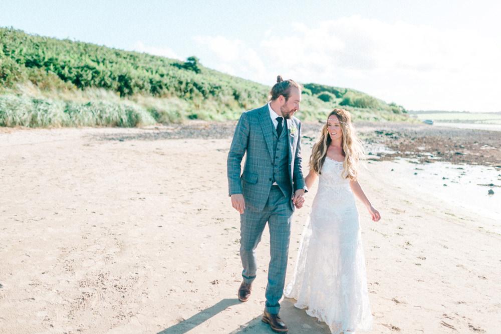 Coastal Budle Bay Marquee Wedding with Yolan Cris Wedding Dress