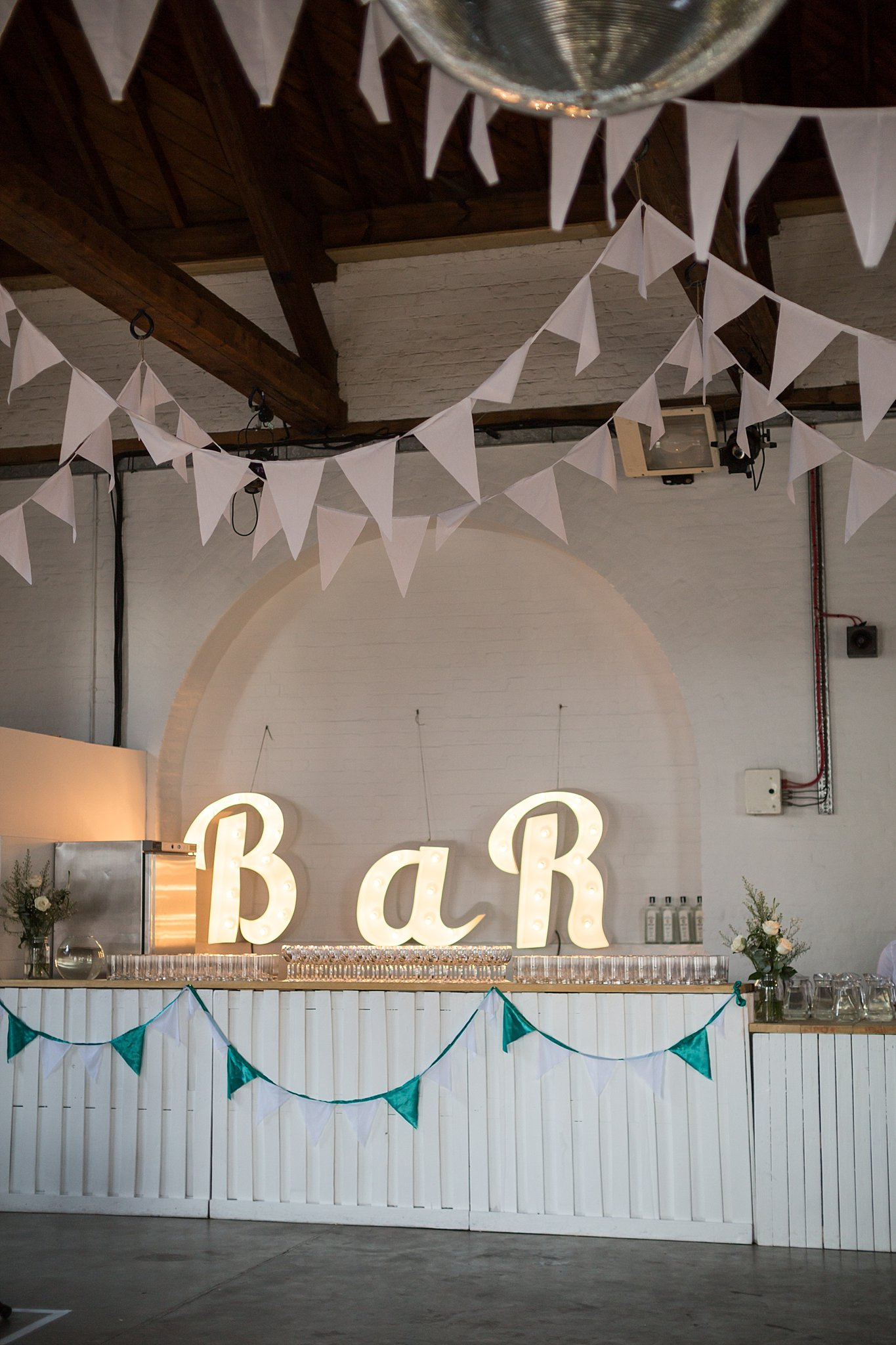 Trinity buoy wharf wedding with lace mon cheri bridal gown marquee lights bunting wedding decor junglespirit Images