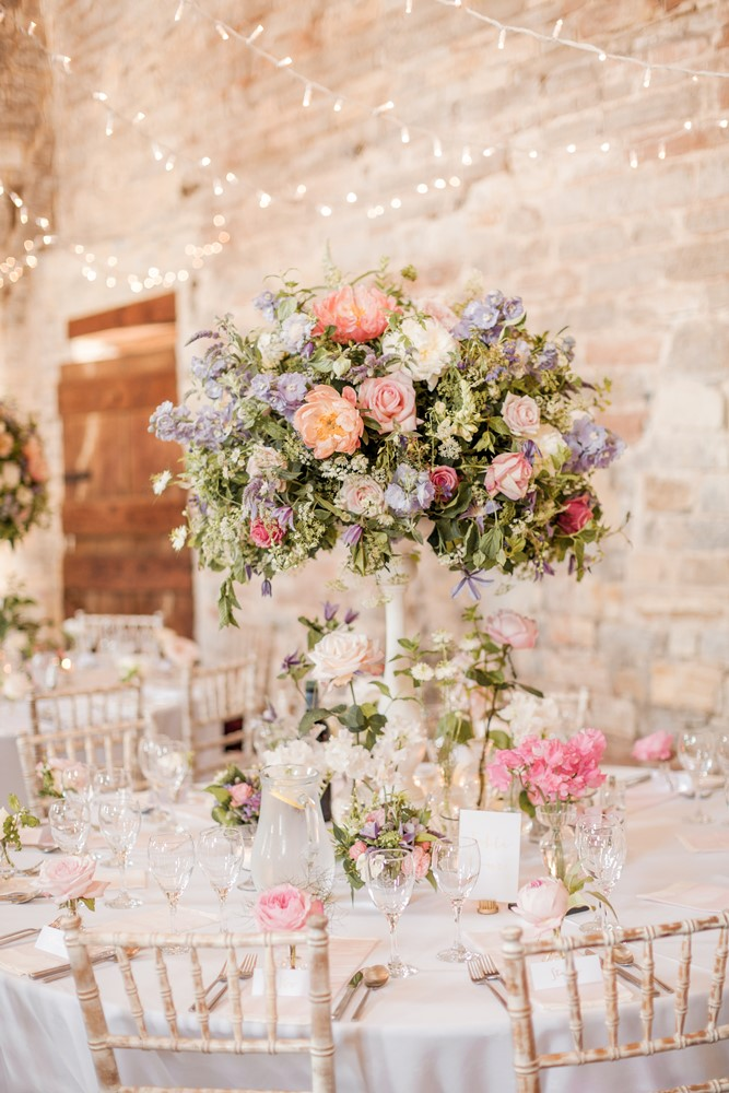 Almonry barn romantic wedding with pink colour scheme for Floral table decorations for weddings