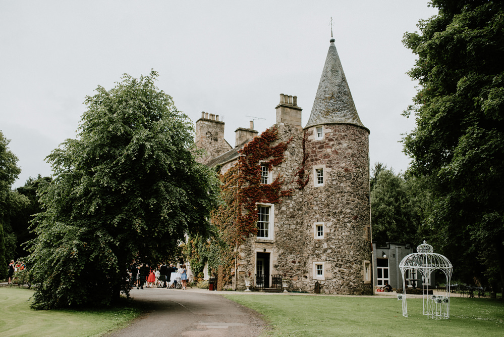 Outdoor Wedding At Fernie Castle In Scotland With Autumnal Flowers