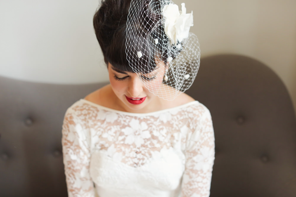 Bride In A Vintage 1950s Short Lace Tea Length Dress With