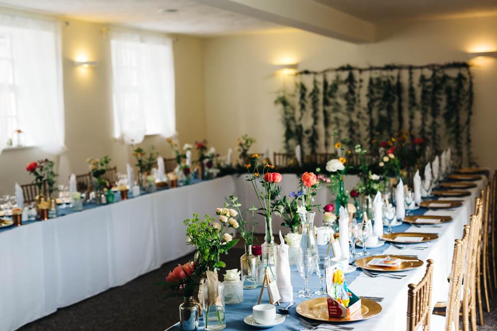 Jess peir bridal gown for an intimate outdoor wedding at botanical wedding reception decor junglespirit Gallery
