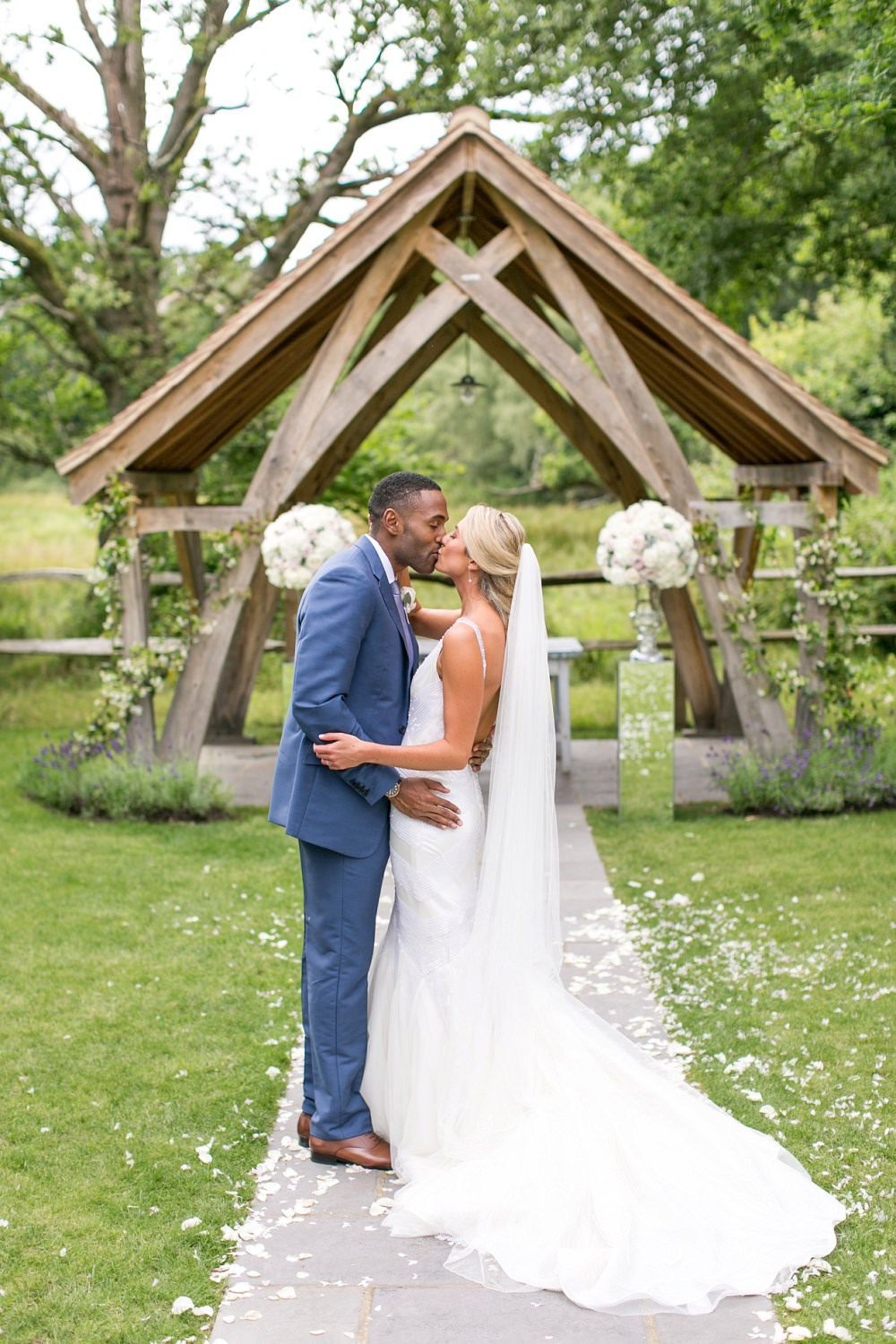 Outdoor ceremony at millbridge court surrey with white hydrangea bride in anita massarella baridal gown groom in navy cad and the dndy suit ombrellifo Gallery