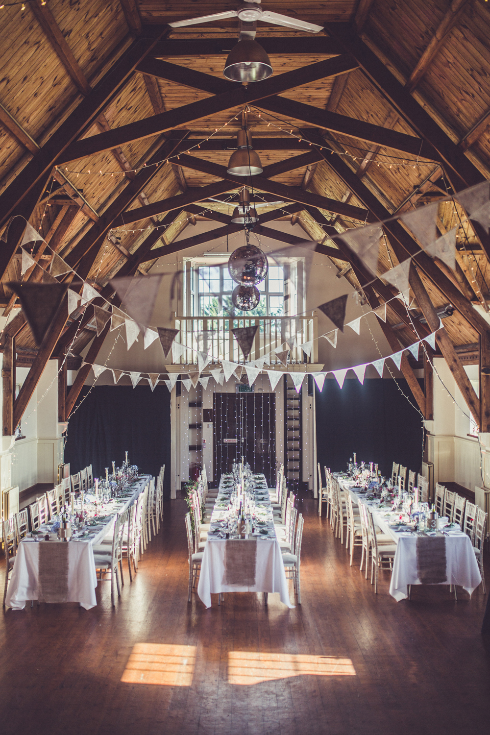 suzanne neville lace wedding dress for a rustic village hall venue decorated with gorgeous. Black Bedroom Furniture Sets. Home Design Ideas