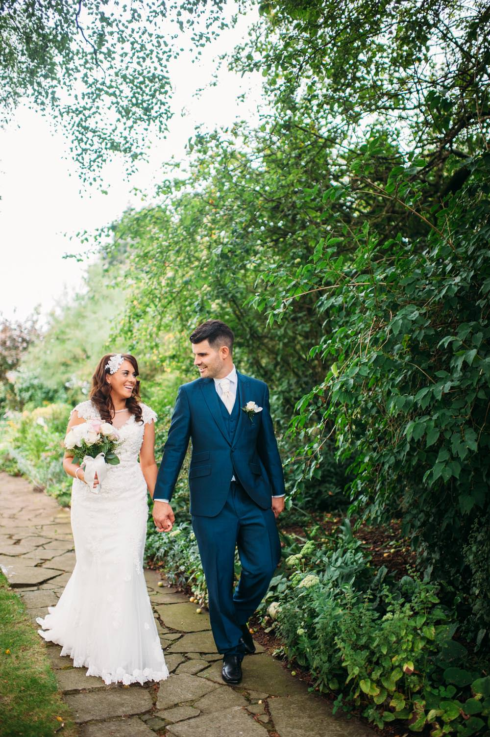 Lace justin alexander wedding dress with pastel bridesmaids navy image by a hrefhttphannah may image by hannah may lace justin alexander fishtail gown for a family orientated classic wedding with navy ombrellifo Choice Image