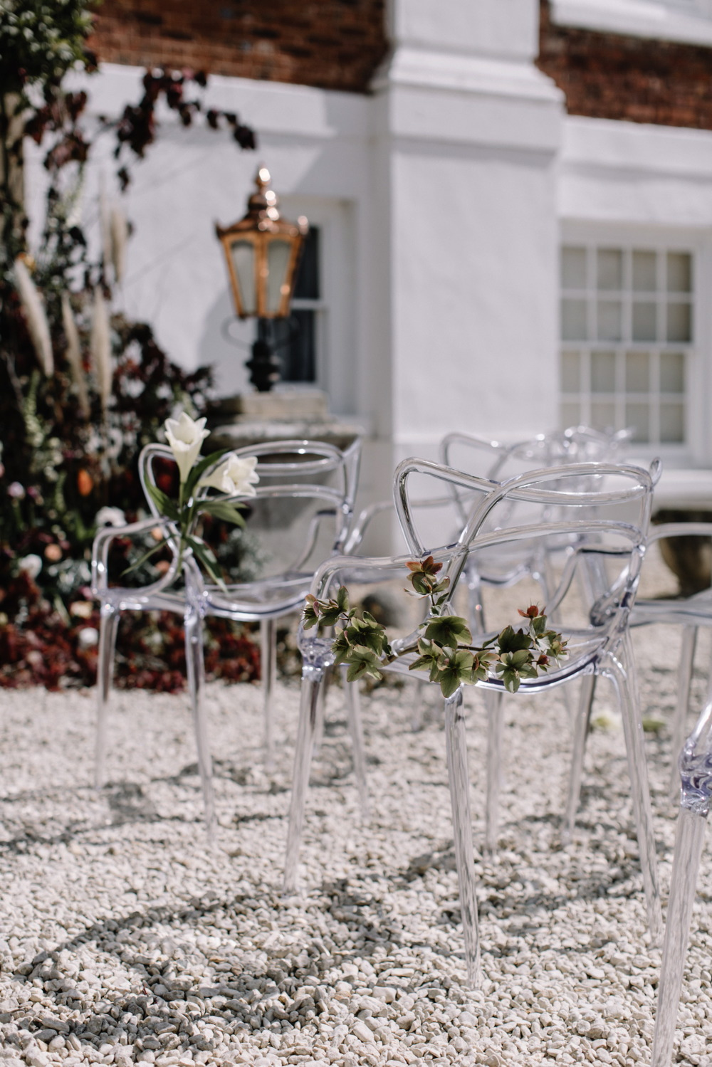 Ghost chairs by wed head outdoor wedding ceremony at pynes house devon image by