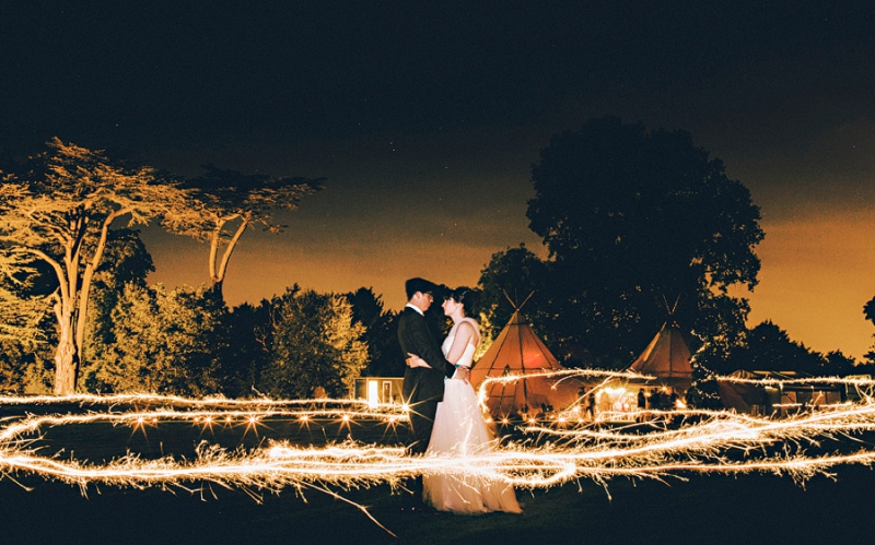 An alternative wedding with bespoke wedding dress and home made blue bridesmaids gowns. outdoor venue with rustic garden games and reception teepee. Photography by Steve Gerrard_0016