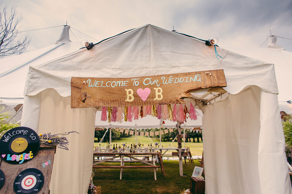 A diy festival themed marquee wedding with the bride wearing claire a diy festival themed marquee wedding with the bride wearing claire pettibone and bridesmaid dresses from coast photography by marie wooton photographer solutioingenieria Images