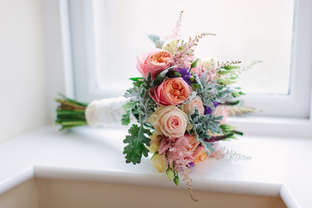 Dorset Wedding With A Peach Pink Vuvuzela Rose Bouquet Mint Green Accents And Bridesmaids In Peach