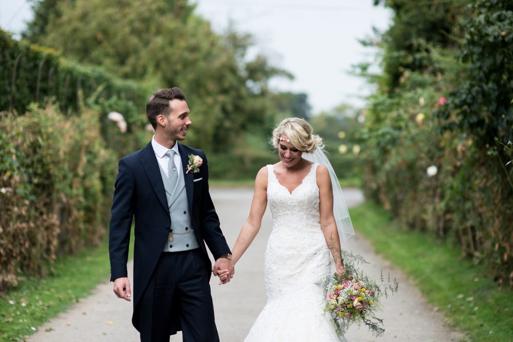 Justin Alexander lace wedding gown & Jim Hjlem Occasions bridesmaid ...