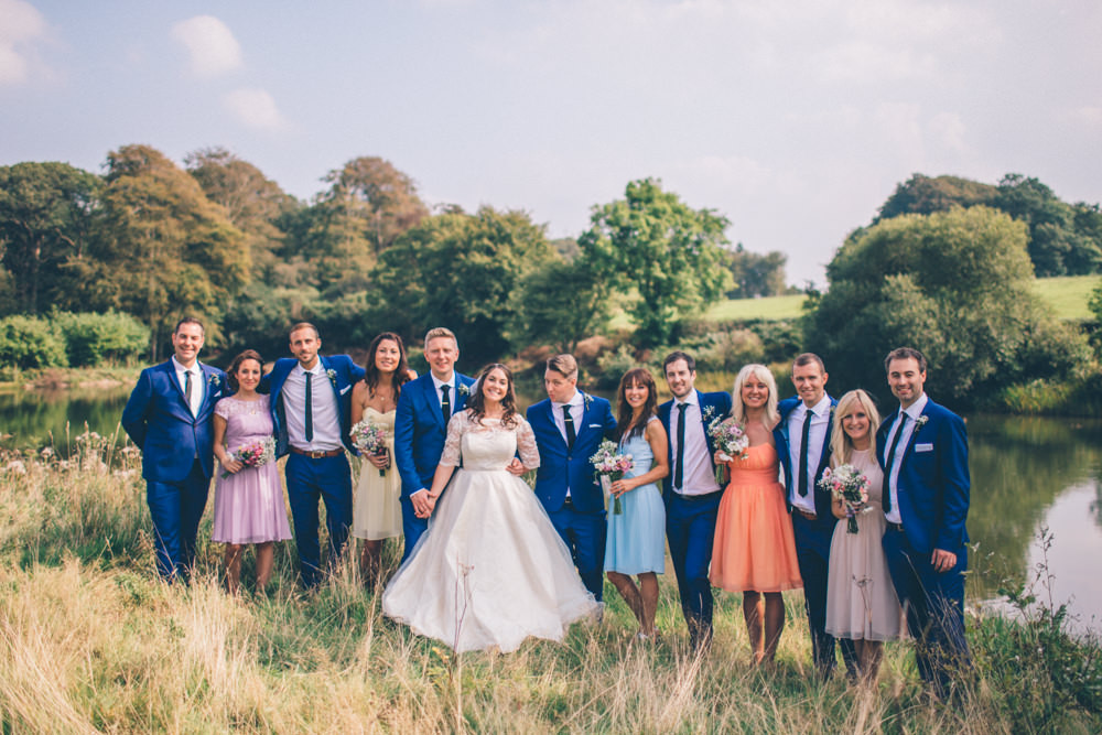 Festival Themed Wedding In Devon With Lace Wedding Dress Pastel