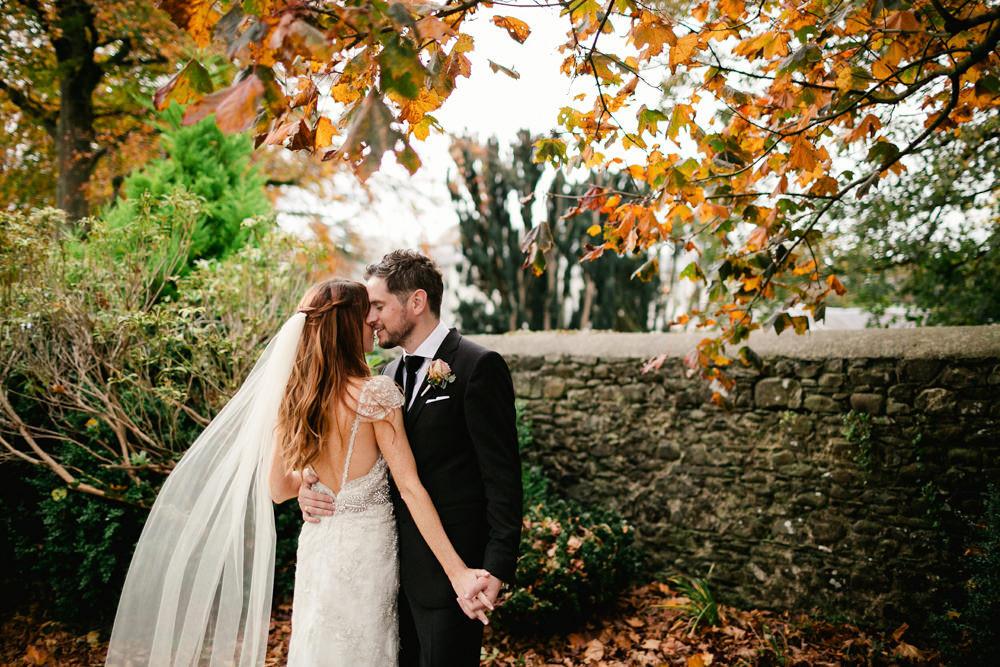 1648edc738574 Bespoke Low Back Embellished Wedding Dress with Purple Bridesmaid ...