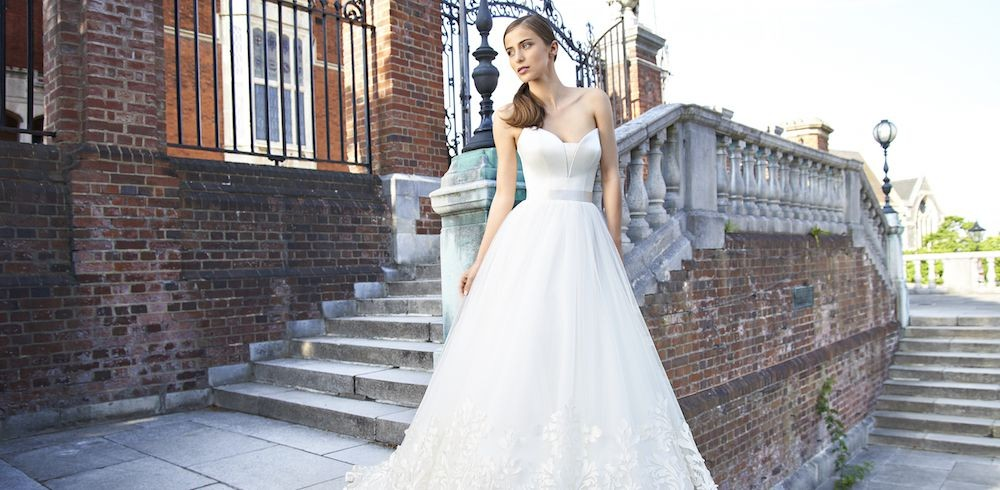 b1de3719576 As one of Europe s leading Designers of bridal and evening wear Suzanne  Neville continue to be at the forefront of British Design.