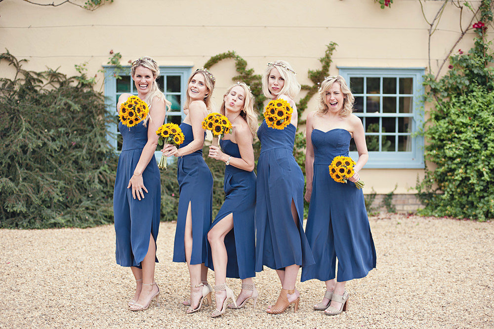 6ea734d125 Reem Acra Eternity bridal gown for a blue and yellow themed wedding at  South Farm in Cambridgeshire with a Sunflower bouquet by Photography by Bea