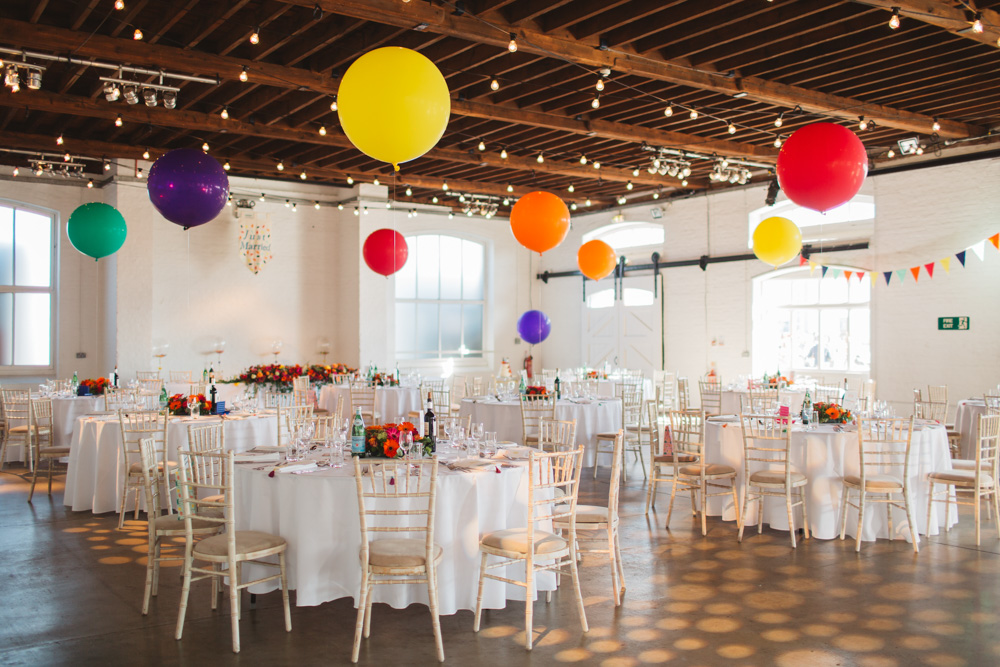 50s inspired wedding with bright colour scheme at trinity buoy wharf brightly coloured balloon wedding decor junglespirit Images