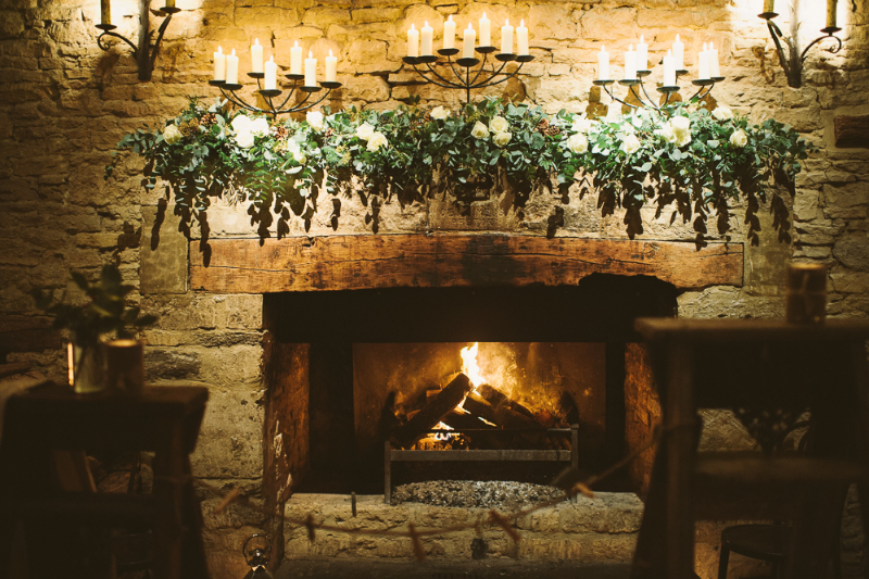 Fireplace Decorated With Candles For A Winter Wedding