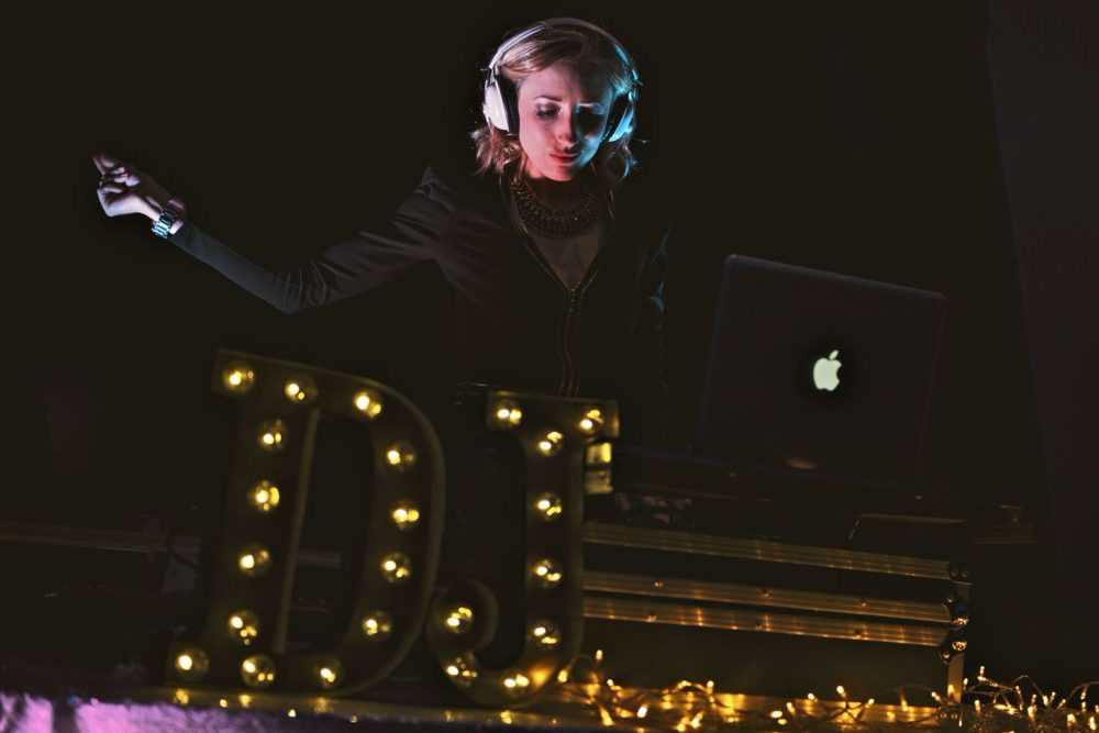 Female DJ with headphones