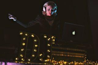 Female DJ with headphones