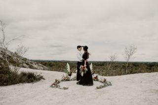 Black Wedding Dress for Wild Same-Sex Couple Wedding Inspiration | Pampas Grass, Eucalyptus & Red Rose Horseshoe Floral Design | Anne Letournel Photography
