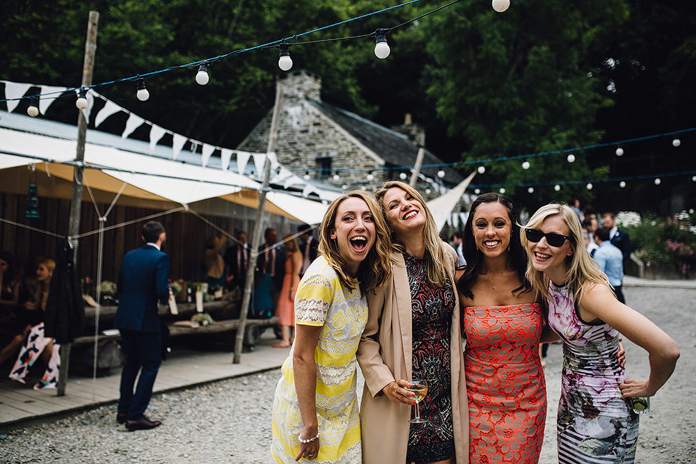 The Best Wedding Guest Dresses | Colourful Spring/Summer Wedding Dresses | Rustic Barn Wedding with Festoon Lights | Image by Samuel Docker