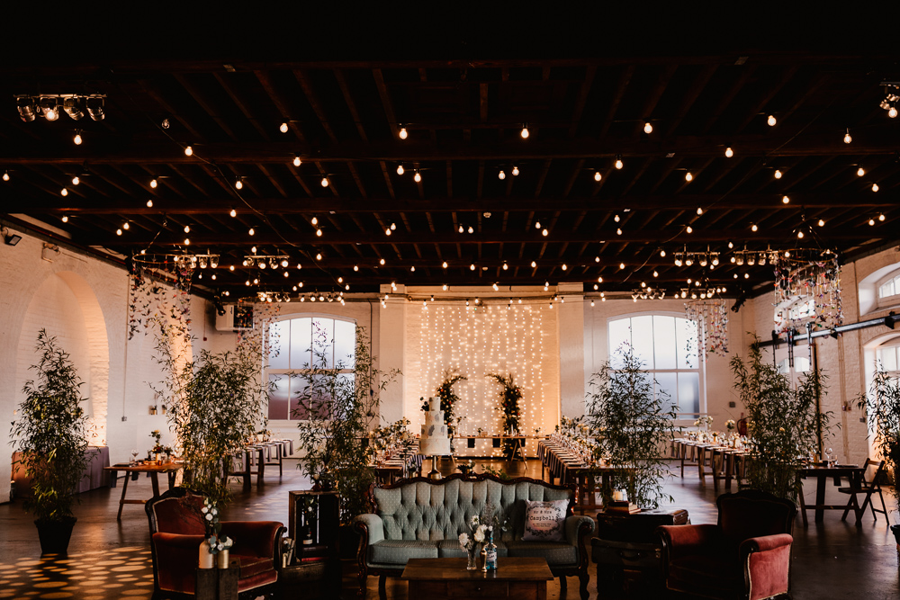String Lights, Perspex Table Signs and Paper Cranes for Industrial Wedding at Trinity Buoy Wharf with Bride in Wtoo Watters, by Frankee Victoria Photography
