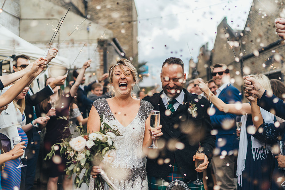 Metallic Confetti Cannons and Paper Lanterns with Bride in Beaded Shoulder Eliza Jane Howell Dress for Stoke Newington Wedding, shot by Miss Gen Photography