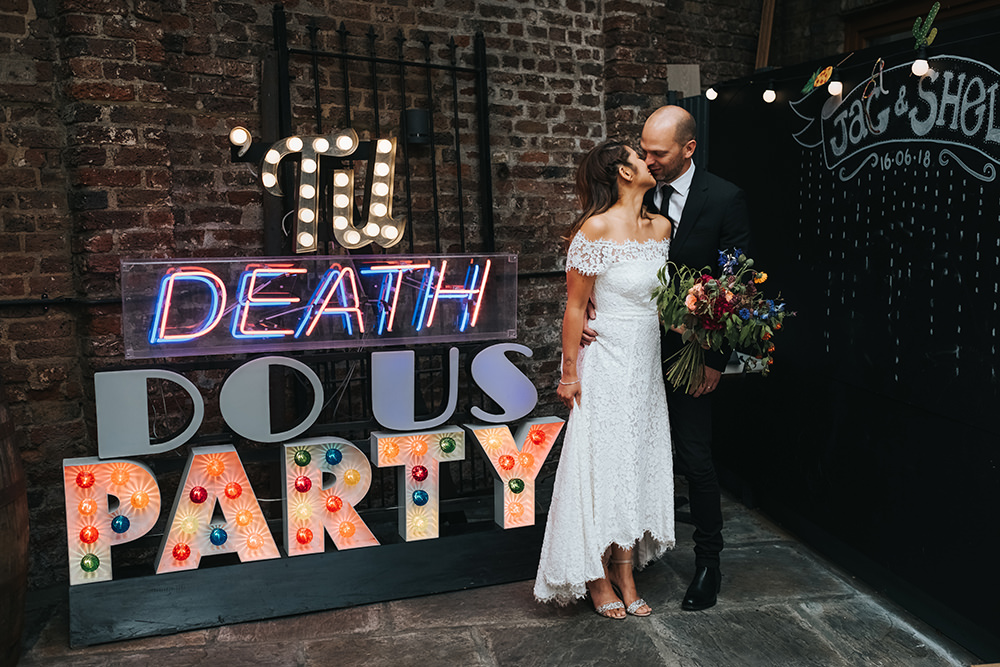 High Street Wedding Dress for an Intimate Crouch End Pub Wedding with Bright Flowers and 'Til Death Do Us Party Neon Sign, shot by Miss Gen Photography