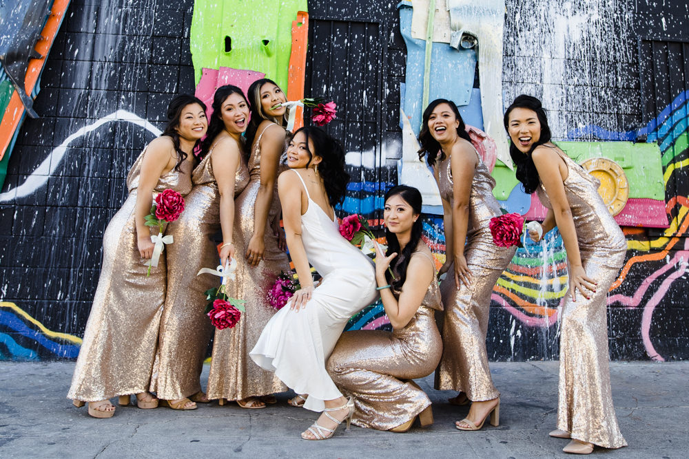 Las Vegas Wedding with Gold Sequin Bridesmaids Dresses and Silk Flowers | BHLDN Wedding Dress | Neon Museum | Chris Barber Photography