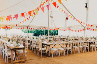 Colourful Bunting Wedding Decor for a Festival Themed Marquee Wedding with Fox Wedding Gown by Rue de Seine, shot by Peppermint Love Photography