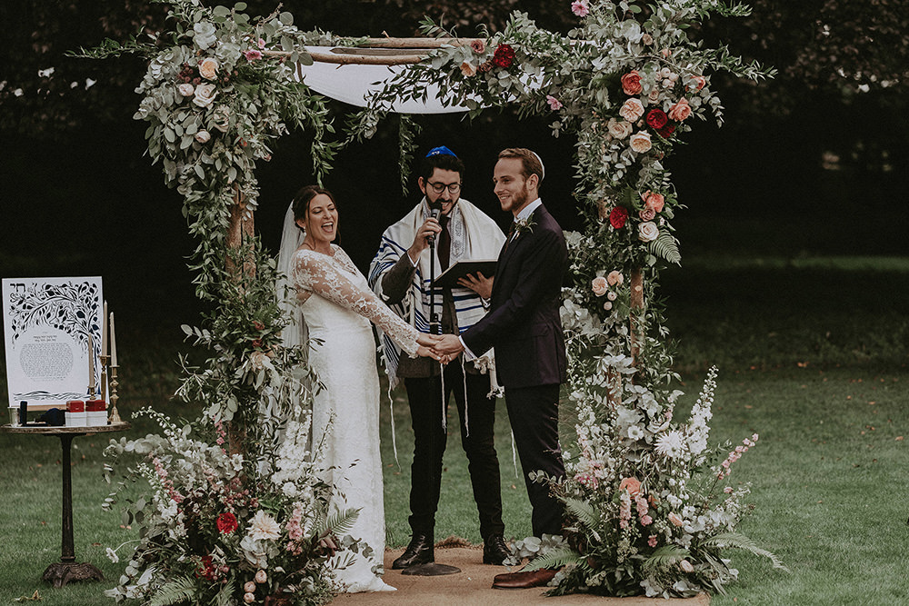 Jewish English Countryside Wedding at Babington House with Floral Chuppah and Bride in Kate McDonald Bridal, shot by Jason Mark Harris