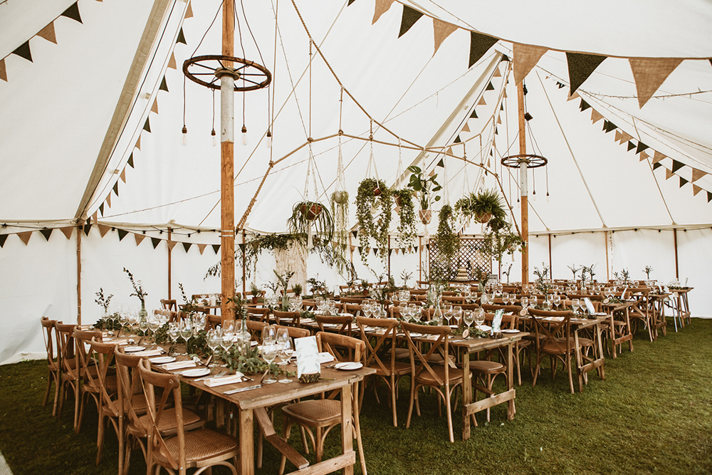 Forest Themed Wedding in a Tipi at Remenham Club with Hanging Plant Pot Decor and Bride in Daughters of Simone Dress, shot by Benni Carol Photography