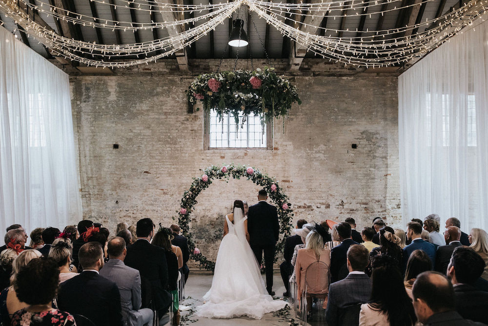 Floral Moon Gate Wedding Décor at Calke Abbey Derbyshire and Doughnut Wall with Bride in Suzanne Neville, shot by Matt Horan Photography