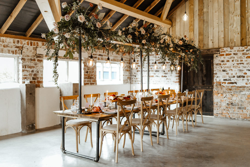 Edison bulb installation, grazing table and eco-friendly florals for a chic, modern, yet relaxed wedding inspiration by Emily K Weddings.