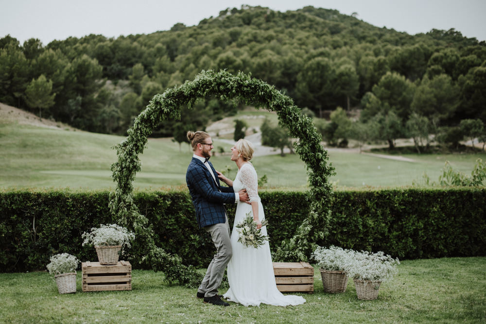 Mallorca Destination Wedding at Biniorella with Greenery Covered Moon Gate Altar and Rembo Styling Wedding Dress by Laura Jaume Photography