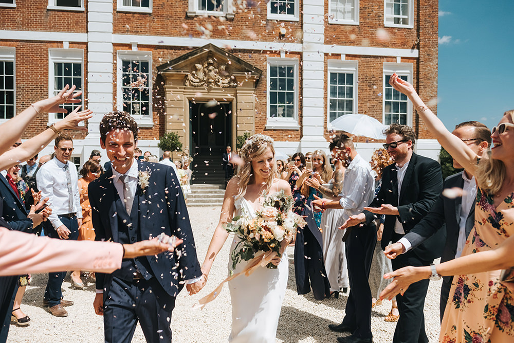 Relaxed, Boho, Pynes House Wedding with Neutral Colours & Bride in Slinky Savannah Miller Chloe Gown with Flower Crown Photographed by Miss Gen