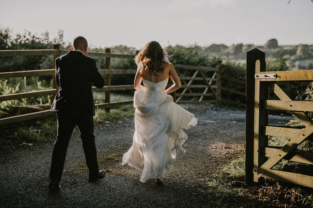 Cornwall Wedding at Trevenna Barn with Bride in Sweetheart Neckline Naomi Neoh Wedding Dress, Fairy Lights, Peonies and Giant Balloons by Nick Walker