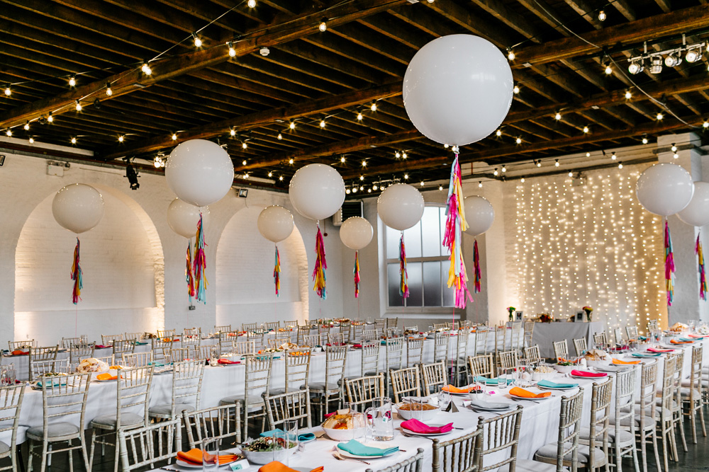 Warehouse Wedding at Trinity Buoy Wharf with Giant Balloons and Colourful Tassels by Epic Love Story Photography and Blooming Lovely Films