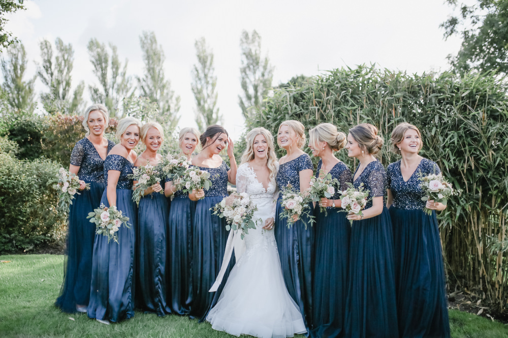 Navy Bridesmaid Dresses And Lace Wedding Dress For A Home Marquee