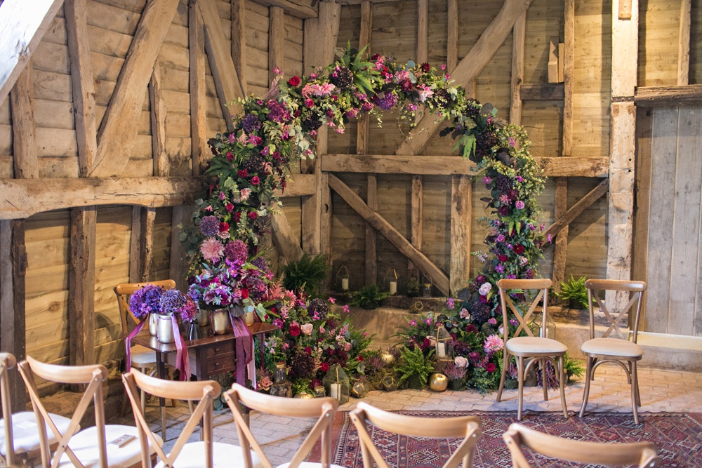Purple Wedding in a Rustic Barn with Floral Moon Gate and Moroccan Rug Altar, Plus a Dessert Table and Cockapoo Ring Bearer by Anneli Marinovic