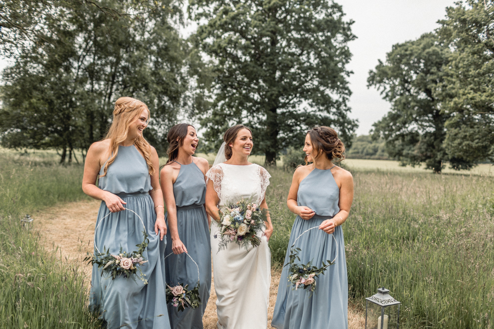 Teepee Outdoor Wedding with Bridesmaids in Blue Dresses, Bride in Charlie Brear Wedding Dress and Groomsmen in Navy Suits by Rebecca Searle