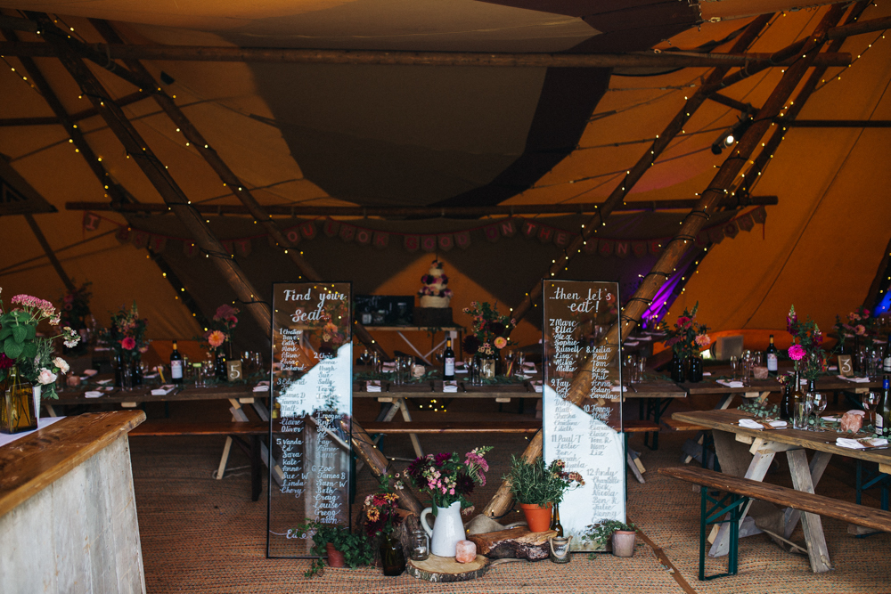Tipi Wedding at Bentley Motor Museum with Wild Flowers, Hand Painted Leather Jackets, Groom in Burgundy Suit and Wood Signs by Sally Thurrell Photography